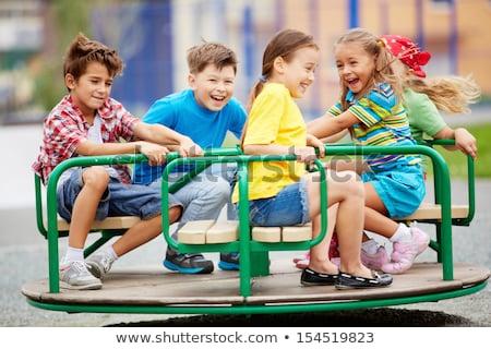 Stock photo: Little girls on merry go round
