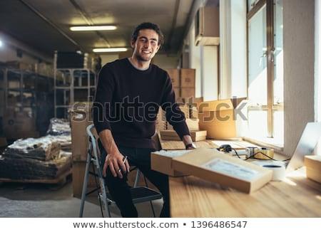 üzletember · szürke · öltöny · tart · laptop · laptop · számítógép - stock fotó © deandrobot