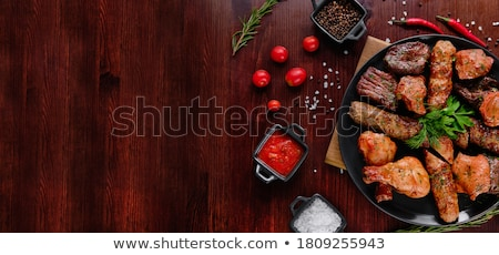 Kebab on the barbecue. stock photo © bryndin