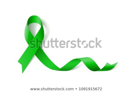 Green ribbon on a white background, as symbol mental health. stock photo © AisberG