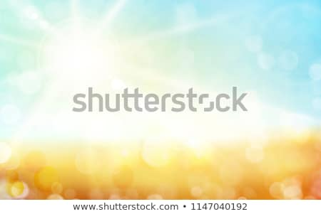 Light green, blue autumn background with sun shine and blurry light dots. Stock photo © wenani