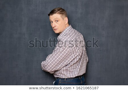 Portrait of a curious middle aged man Stock photo © deandrobot