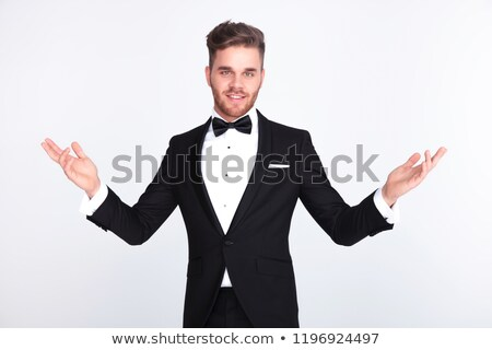 elegant man in tuxedo making a welcoming gesture Stock photo © feedough