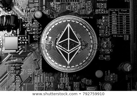 Ethereum coin on a computer motherboard Stock photo © grafvision