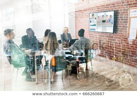 Stock fotó: üzletasszonyok · videó · konferencia · iroda · üzlet · technológia