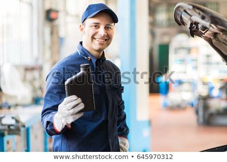 Autószerelő tart kancsó motorolaj kék dolgozik Stock fotó © Minervastock
