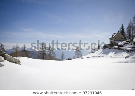 Winter landscape with mountain huts and a path in the snow Stock photo © Kotenko