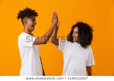 izgatott · érzelmes · fiatal · aranyos · afrikai · pár - stock fotó © deandrobot