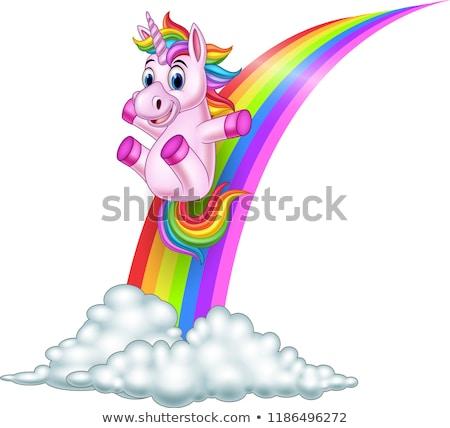 Happy unicorn on rainbow slide Stock photo © bluering