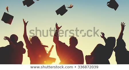 boldog · diplomás · ünnepel · pózol · sapka · talár - stock fotó © dolgachov