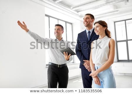 realtor with tablet pc and customers at office Stock photo © dolgachov
