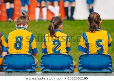 Kids girls elementary school sports team sitting on bench Stock photo © matimix