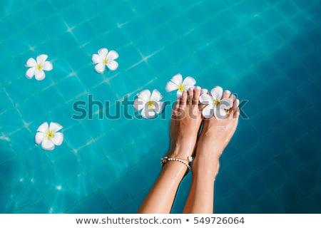 Güzel kadın ayaklar yüzme havuzu beyaz kadın Stok fotoğraf © dashapetrenko