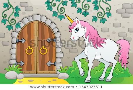 unicorn by old door theme image 1 stock photo © clairev