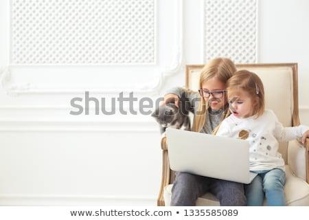 Deux adorable soeurs portable ensemble Photo stock © dashapetrenko