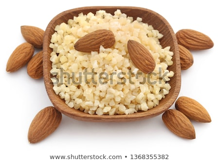 Small pieces of chopped almonds with whole ones Stock photo © bdspn