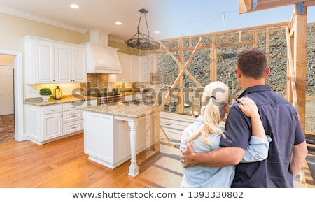 Couple Facing Construction Framing Gradating To Completed Home Stock photo © feverpitch