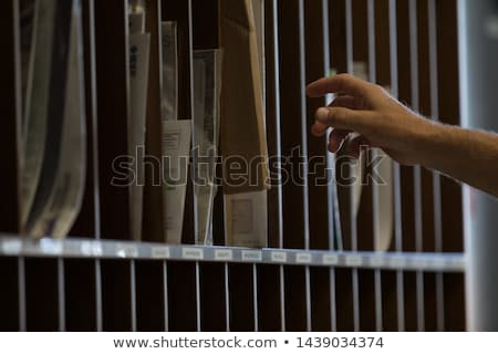 Male hand reaching for sorted post or mail Stock photo © Giulio_Fornasar