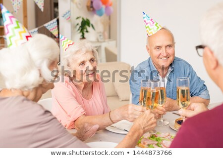 Csoport boldog idős barátok fuvolák pezsgő Stock fotó © pressmaster