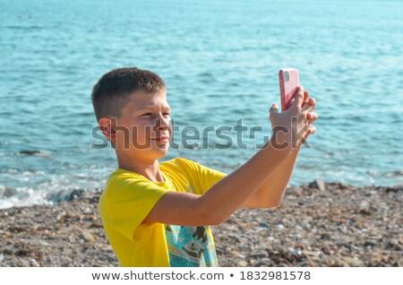 portre · plaj · adam · şapka · düşmek - stok fotoğraf © monkey_business