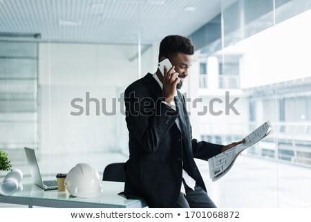 negócio · executivo · falante · celular · jovem · empresário - foto stock © lichtmeister