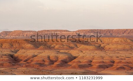 Woman on a rock with views of sunset over mountain valley gorge Stock photo © lovleah