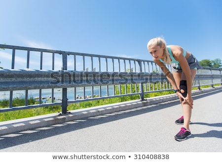 young woman with knee support brace on leg Stock photo © dolgachov