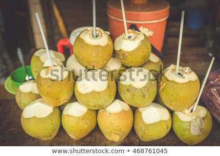 Coconuts in the Vietnamese market, typical street food business in Asia Stock photo © galitskaya