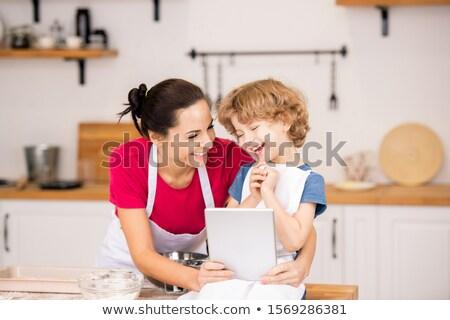 Alegre menino mãe risonho vídeo touchpad Foto stock © pressmaster