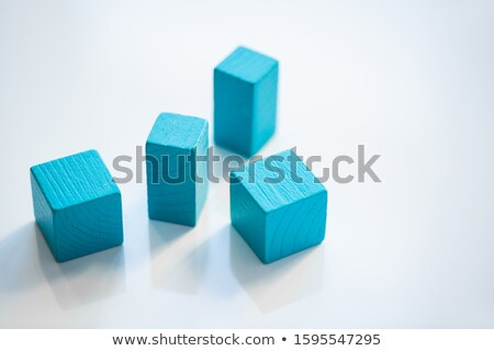 Group of blue flat wooden bricks and cubes standing in random order Stock photo © pressmaster