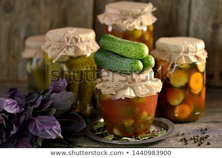 Pickled cucumber and tomatoes Stock photo © elxeneize