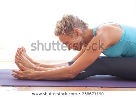 Kıdemli kadın vücut yoga mat esneklik Stok fotoğraf © Illia