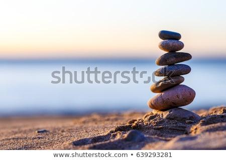 Pirámide mar guijarros aislado blanco vida Foto stock © karandaev