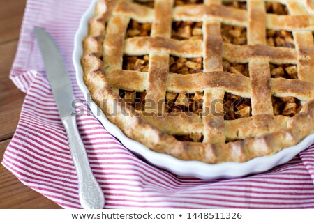 close up of apple pie in baking mold on towel Stock photo © dolgachov