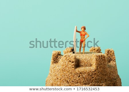miniature surfer woman on a sandcastle Stock photo © nito