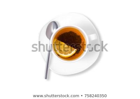 Copo pires chá fatia limão branco Foto stock © boroda