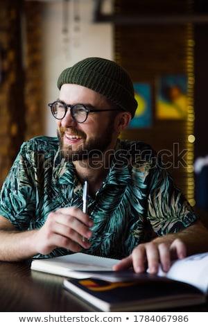 Biznesmen posiedzenia piśmie plan dziennik Zdjęcia stock © HASLOO