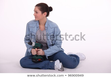 Woman sat on floor with power drill Stock photo © photography33