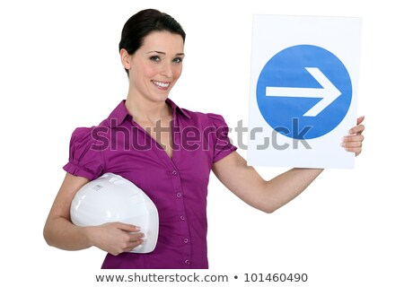 Woman holding sign of obligation to turn right Stock photo © photography33