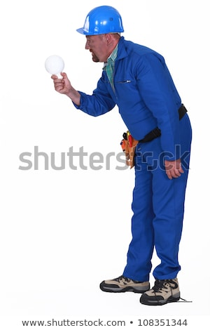 Electrocuted man staring at a light bulb Stock photo © photography33