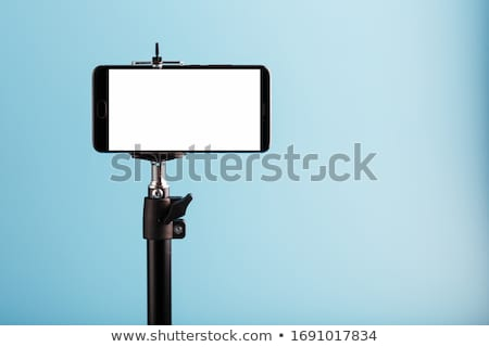Camcorder on portable tripod. Stock photo © borysshevchuk