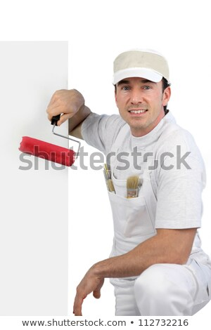 decorator kneeling by blank poster stock photo © photography33
