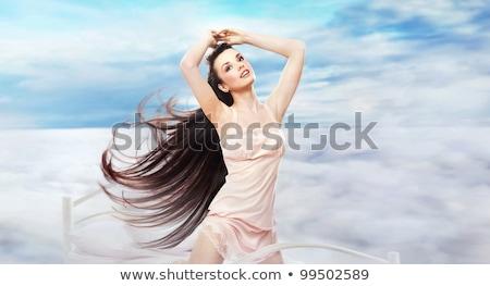 Hosszú hajú barna hajú álomszerű díszlet boldog fény Stock fotó © konradbak