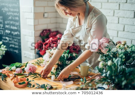 Male florist with a bunch of flowers Stock photo © photography33