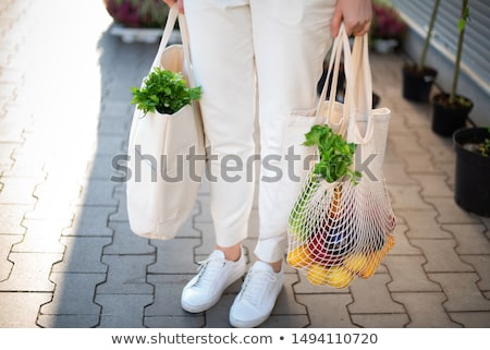 Hand holding reusable shopping bag Stock photo © Taigi