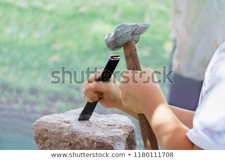 Worker holding hammer and chisel Stock photo © photography33