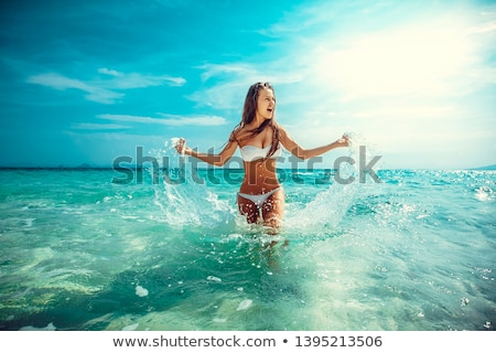blonde girl on beach Stock photo © zastavkin