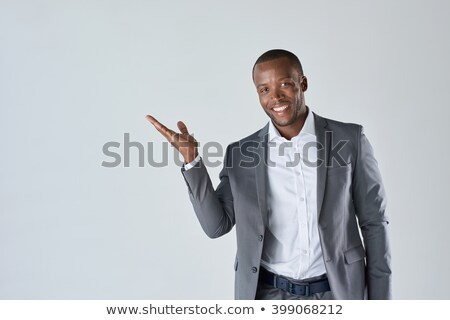 business man points holding jacket stock photo © feedough
