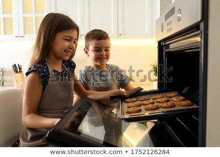 Portrait of smiling brother and sister eating biscuits Stock photo © wavebreak_media