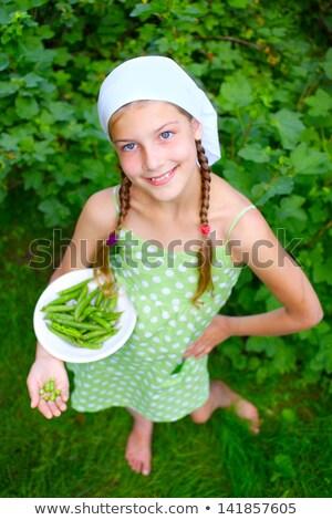 Girl holding green grapes Stock photo © ElinaManninen